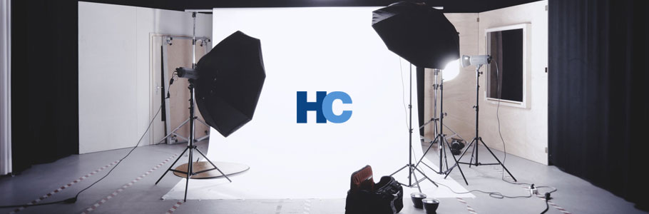 Harrison Camera logo with a studio background.