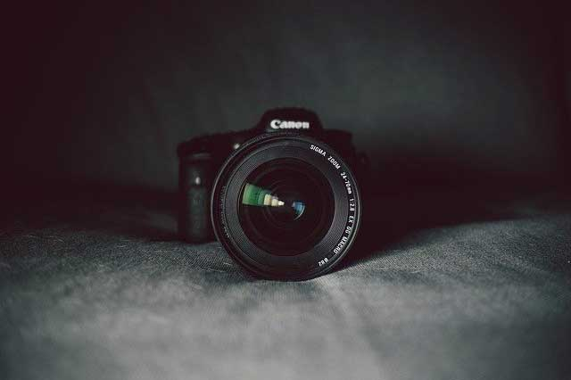 A Canon camera against a grey backdrop