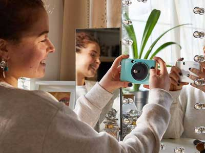 Woman taking a selfie with the Canon Zoemini C