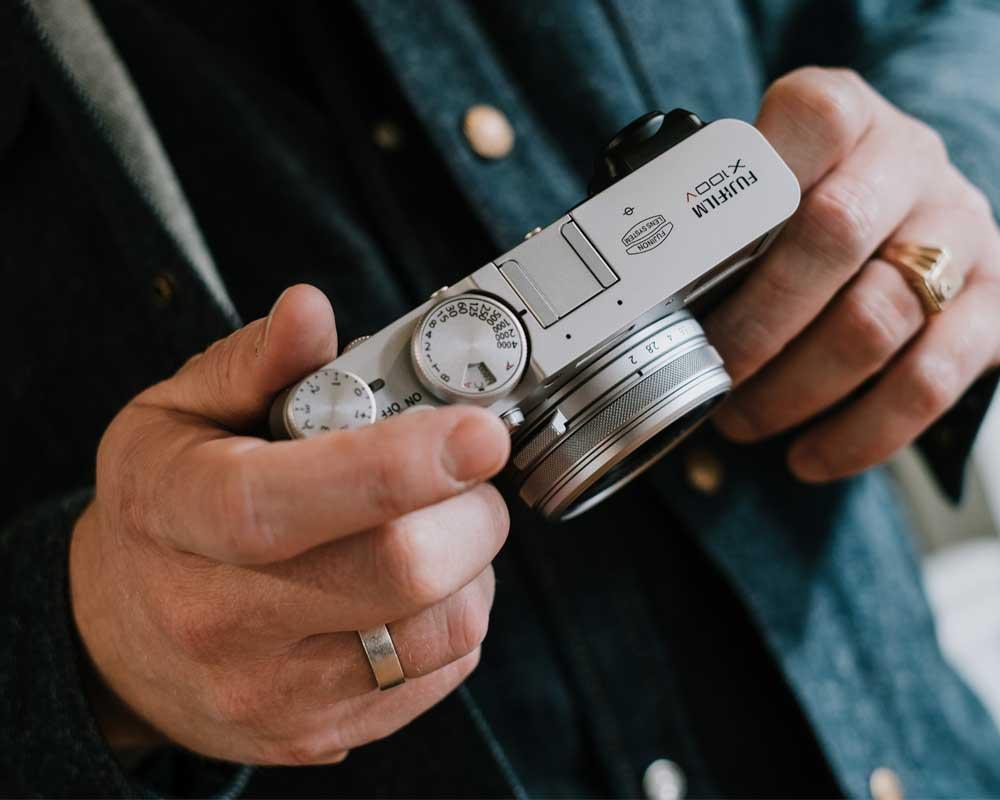 Person holding the Fujifilm X100V.