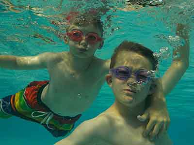 Kids underwater shot by the Nikon W150