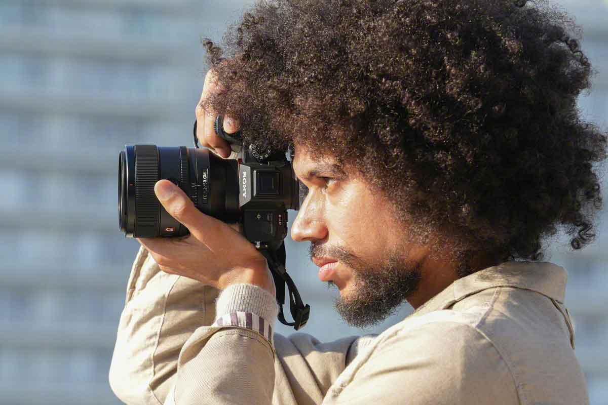 Man with afro using the Sony 50mm lens.